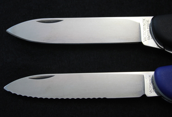 Comparison between a standard plain-edge blade and a partially-serrated 111mm blade.