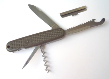 This Victorinox German Army Knife(GAK) is a later revision, sometimes referred to as the GAK-2, because it has the nail-file/match-striker textured area on the size of the saw/combo-opener tool.