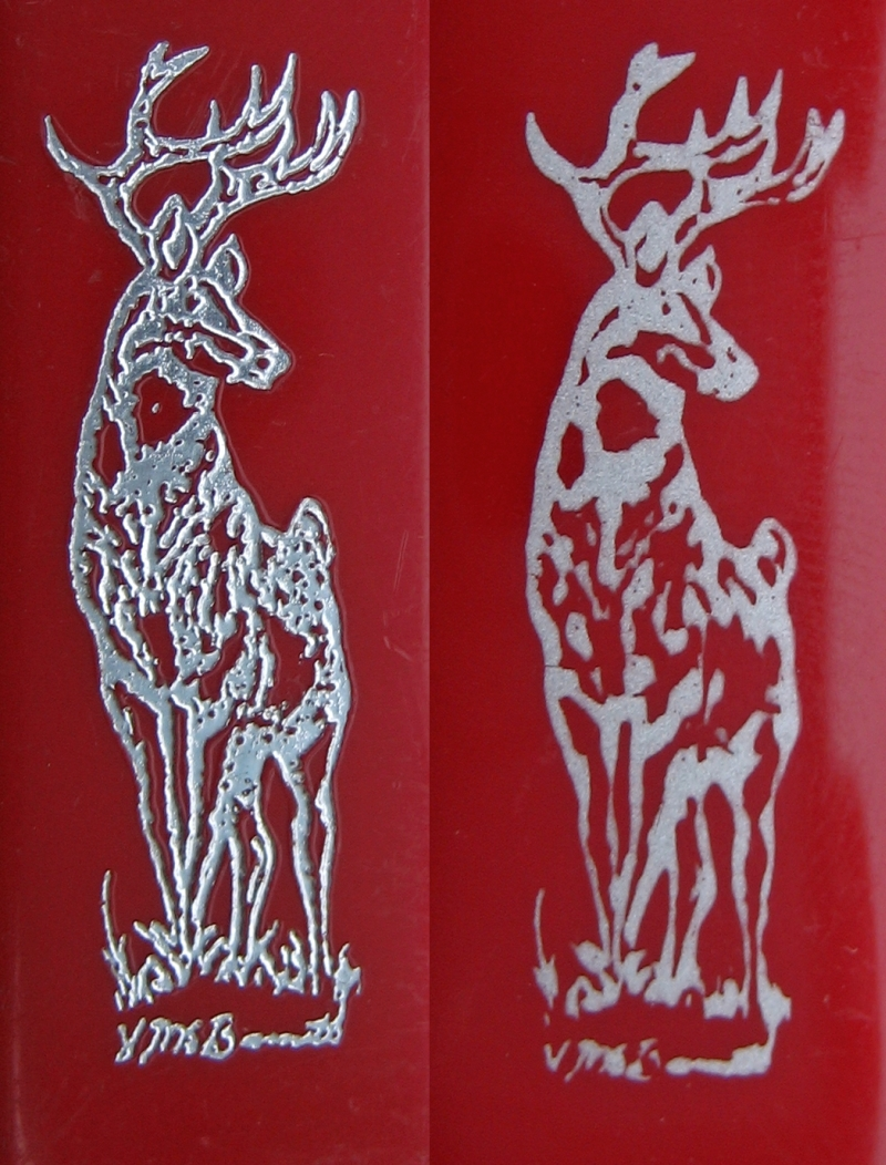 Deer imprint. Older model on the left, newer on the right.