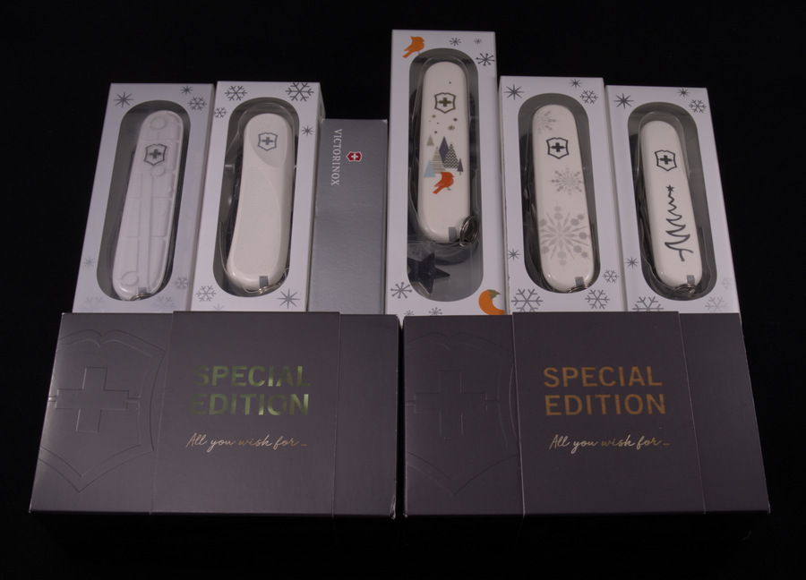 "Victorinox Christmas Series boxed. Top line from left to right: Climber White Christmas 2015, Evolution White Christmas Special Edition 2016, Climber Christmas Knife ""Make a Wish"" Special Edition 2016, Super Tinker Winter Magic Special Edition 2019, Explorer White Christmas Special Edition 2017, Sportsman White Christmas Special Edition 2018. Bottom line from left to right: Climber Christmas Knife ""All you wish for...""  Special Edition 2018."